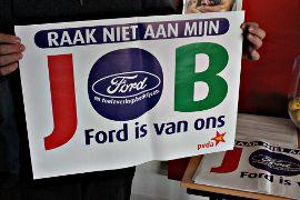 Plakat: auf flämisch »Raak niet aan mijn job«.